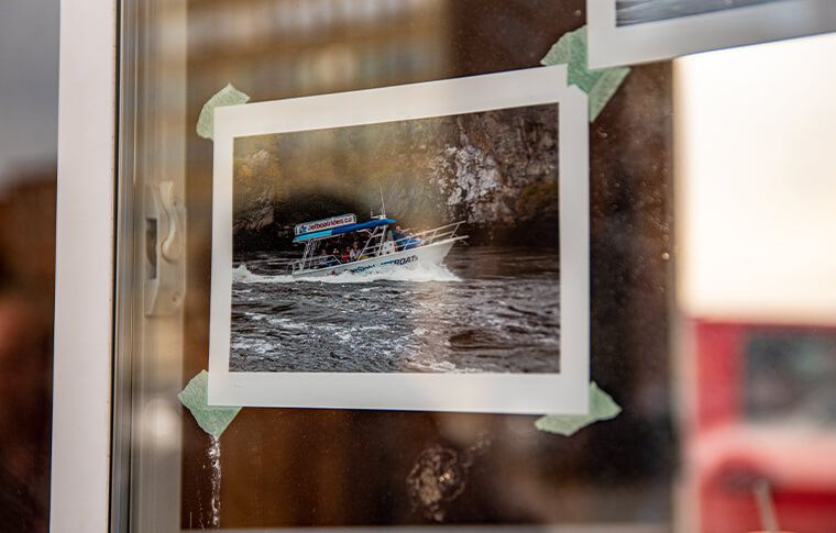 a photo of a boat taped to a window